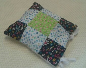 Black, blue, white and green patchwork cushion cover.