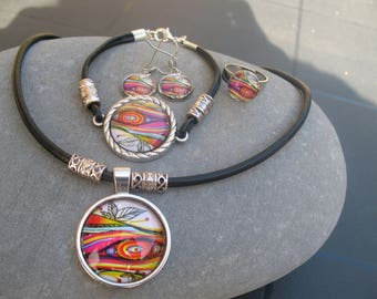 Set in glass cabochon with leather cord