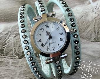 Ladies size watch. S cuff round watch Silver Blue bracelet with Rhinestones