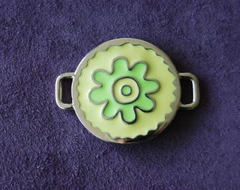 Enameled in-between, yellow and lime green.