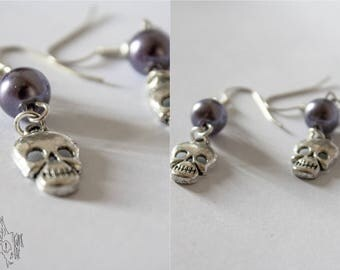 Drop earring, with charm and beads.