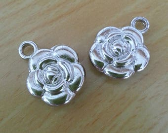 Flower. Flower shaped silver acrylic charm. Sold by 2