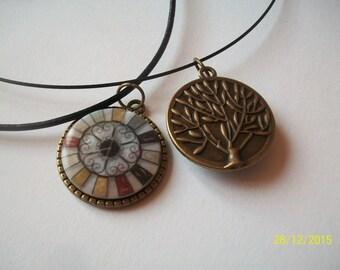 bronze color pendant with a glass cabochon