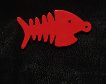 Red fish skeleton charm/pendants.