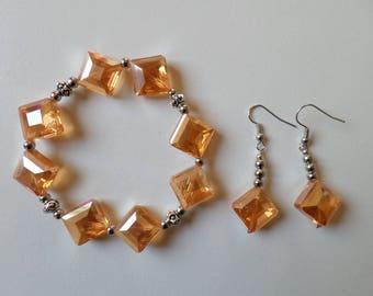 Orange diamond-shaped glass beads earrings