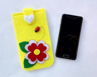 Cell case in yellow felt with flower and wooden ladybug.  Yellow felted cell phone case with flower and ladybug in wood.