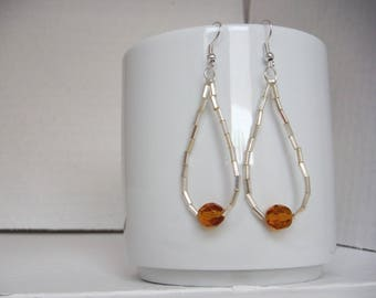 tear drop earrings with gold-coloured glass beads and Crystal amber pearl/earrings