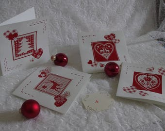 Set of 4 different Christmas red and white collage cards.