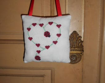hand - embroidered pillow of door ladybugs