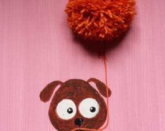 A cute little dog is inviting orange ball