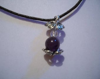 Brown cord and amethyst and rock crystal pendant