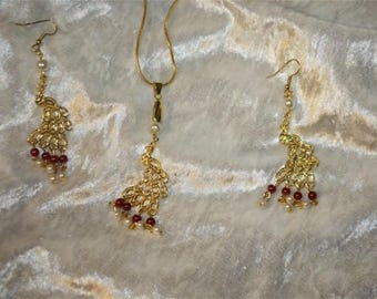 Gold Peacock earrings with chain