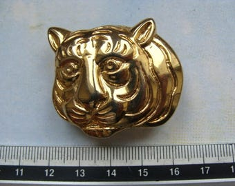 Gold tiger head piece