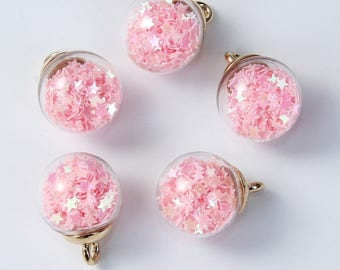 Charm / pendant glass globe filled with pink stars