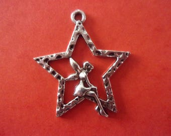 Pendant star with a fairy sitting on the inside, silver color metal - 3cm x 2.5 cm