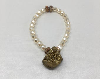 Beautiful pearl crystals made with amber gold accents and a gold druzy charm