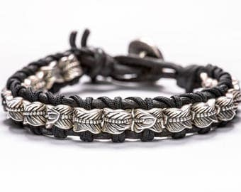 Leather bracelet with 925 Sterling Silver feather beads