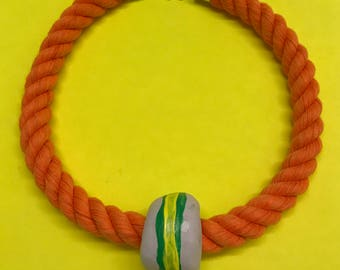 One bead necklace on orange rope