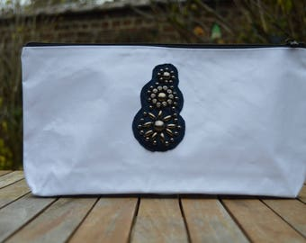 Pocket with decorative lace