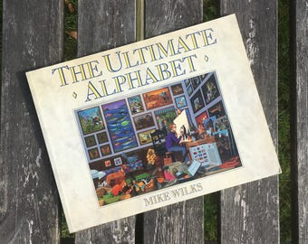 The Ultimate Alphabet - a hidden clue book by Mike Wilks with fantastically detailed illustrations for each letter from A to Z. Gift for him