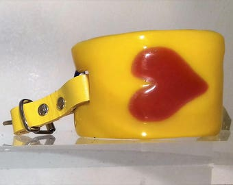 A Yellow Glass Bracelet with Red Glass Heart.