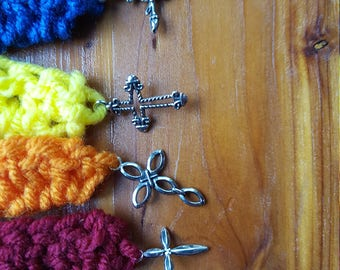 Crocheted bookmark with cross charm