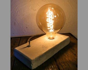 Lamp with concrete filament bulb