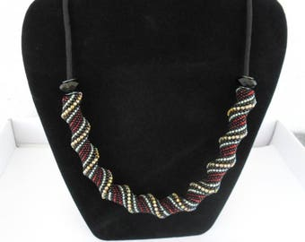 Spiral necklace with seed beads