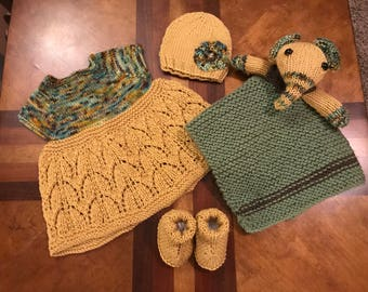 Hand knit baby set includes dress, hat, booties, and lovey blanket