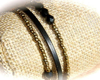 LEATHER STRAP AND BLACK BEADS AND GOLD
