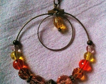 Bronze necklace in double circle and citrus beads