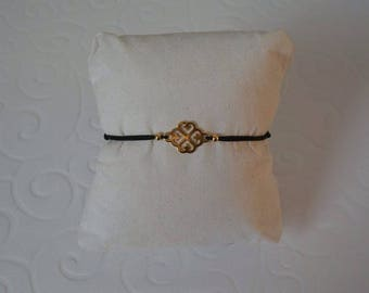 Cord and gold clover bracelet