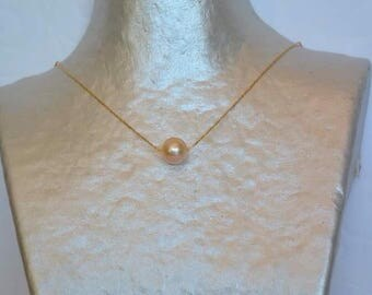 Necklace on gold chain peach cultured pearl