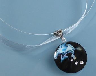 Sky blue and black swirl polymer clay pendant