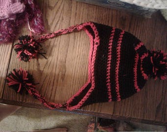 Red and Black pom pom hat