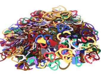 Colored heart confetti. table confetti