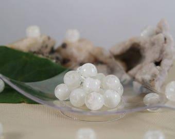 Glow. 8 mm, hole: 1.3 mm, 10 round lampwork beads, white interior
