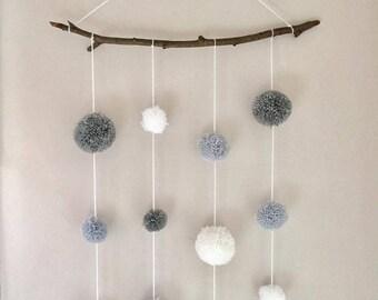 Grey and white pom pom wall hanging