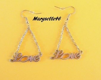 """The word """"Love"""" silver chain and silver plated metal earrings"""