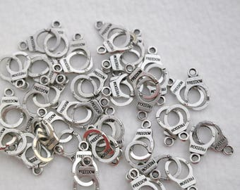 Set of 10 handcuff charm, connector, silver 30 mm