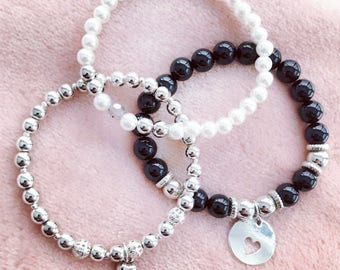 Trio of bracelets with love