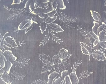 Piece of vintage white organdy fabric embroidered flowers