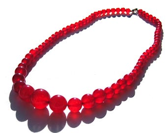 Collier rubis perles de 6,8,10,12,14 mm et fermoir mousqueton.