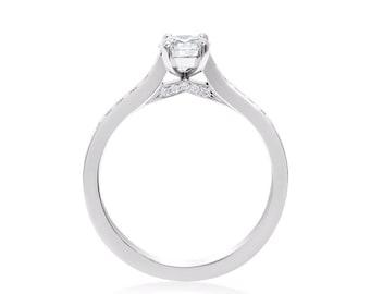 Custom made platinum and diamond engagement ring