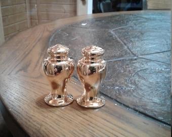 Vintage gold salt and pepper shakers