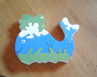 7 piece wooden whale