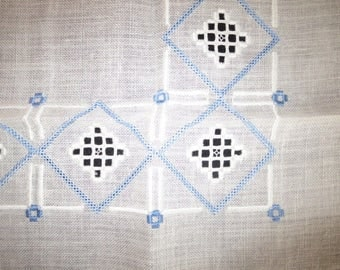 Linen blanket embroidered in Hardanger technique