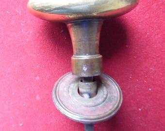 Brass door handle. 19th century