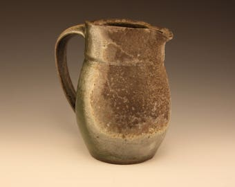 Green and White Ceramic Pitcher