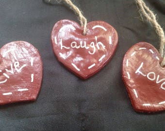 Heart Shaped ornament with the saying Love
